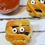 These Mummy Meatballs are the perfectly fun way to add spooky entertainment to your Halloween feast! Click Now!