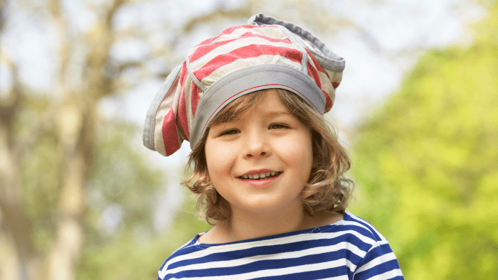 little boy with underwear on head