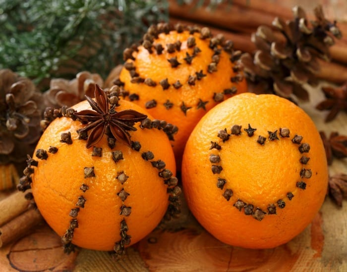 Cloves and oranges are a classic holiday craft that emulates the fresh and vibrant scents of the season