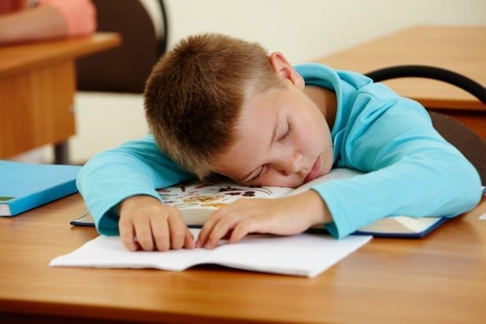 sleeping kid at school