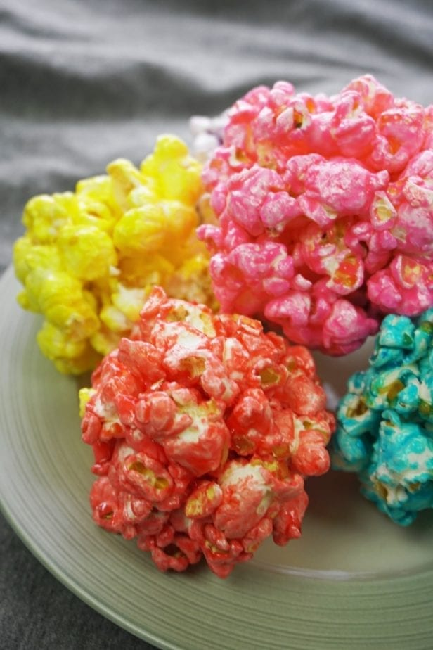Oh, Snap! Easy Infinity Stone Popcorn Balls were out in the universe, but now they've been gathered--and I am so happy about it. #avengers #avengerspartyfood #avengerspartyidea #infinitywarfood #infinitystones #popcornballs