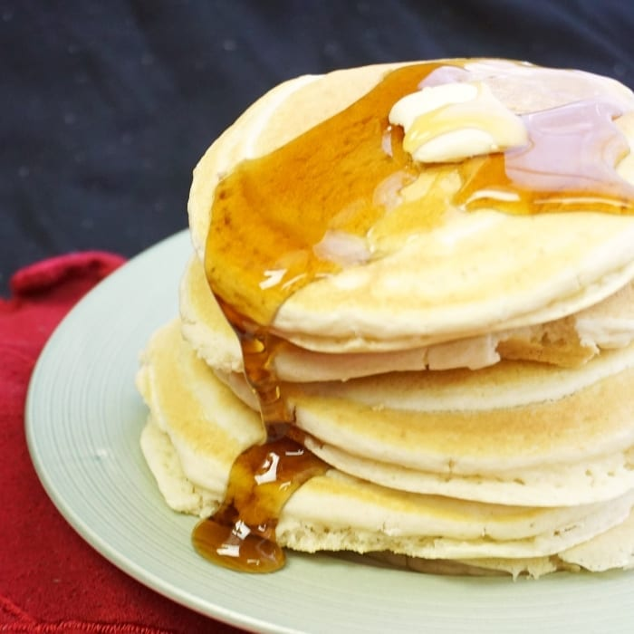 Saturday mornings could be super-boring for us. But that sounded bunk so I came up with this recipe for Ridiculously Fluffy Vegan Pancakes. #vegan #pancake #pancakerecipes #veganpancake #veganrecipes