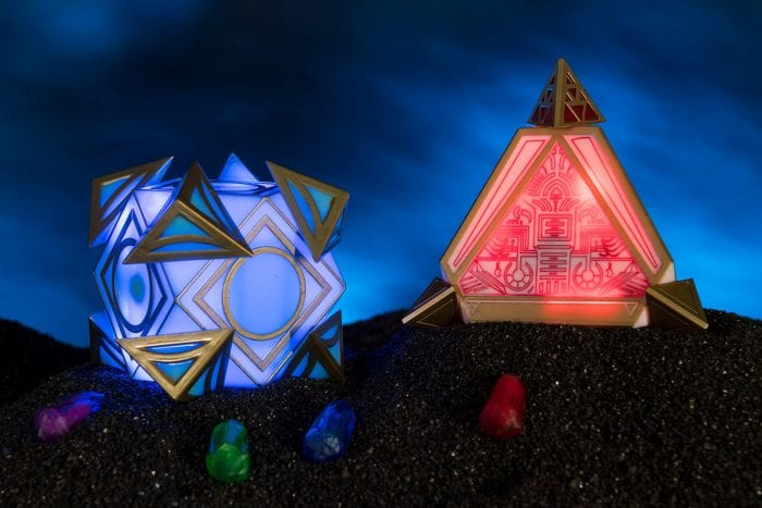 Holocrons in red triangle shape and blue cube shape that will be available for purchase as souvenirs at Star Wars: Galaxy's Edge.