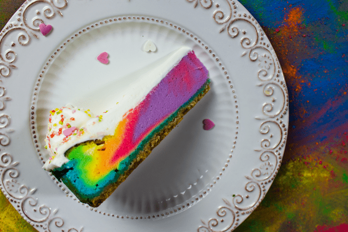 "If you've ever tried to make a cheesecake, you're like ""oh, this should be easy"" and then it's a nightmare with water baths and all sorts of crazy. But this Freaktacularly Simple Unicorn Cheesecake looks hard--but it's so simple I die."