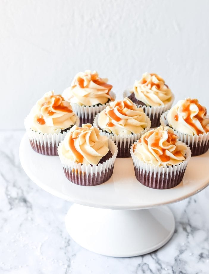 If you were hoping for a classic death-by-dessert, let me assure you that these decadent and creamy Salted Caramel Cupcakes deliver. #saltedcaramel #saltedcaramelcake #saltedcaramelcupckes #caramel