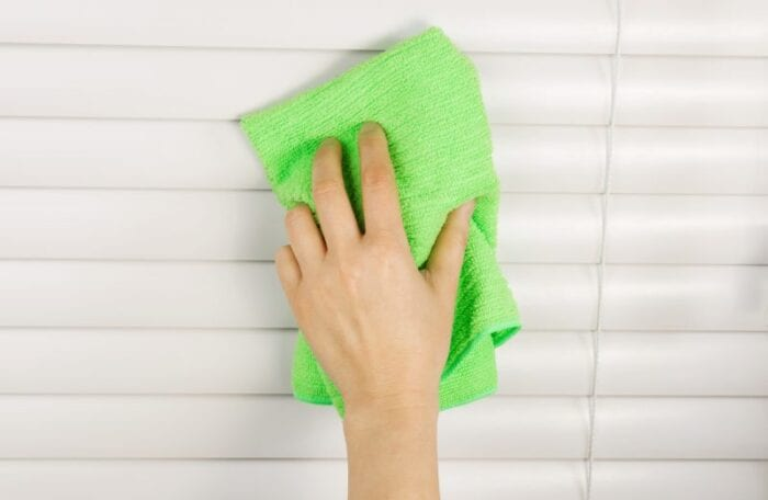 cleaning blinds with microfiber towel