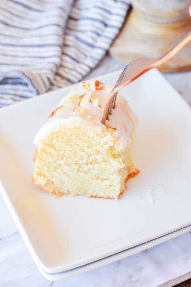 I'm in Love with this Almond Bundt Cake. It's so simple and such an easy cake to make--and it turns out soft and fluffy every time. So good. #cake #almondbundtcake #bundtcake #almondcake