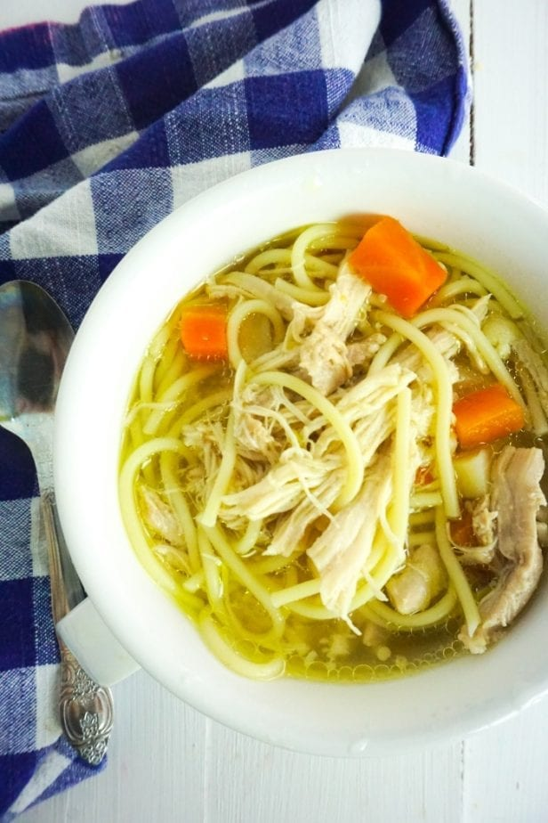 When I get sick or my kids are sick, I always want soup. And this is the Easiest Homemade Chicken Noodle Soup on the Planet. It'll knock your socks off with flavor. #chickennoodlesoup #howtomakechickennoodlesoup #homemadechickennoodlesoup