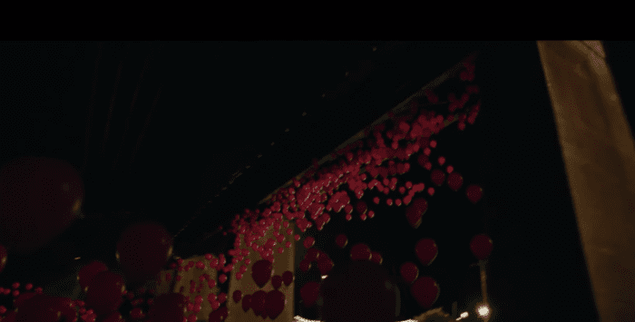 Red baloons in a scene from the movie IT: Chapter Two