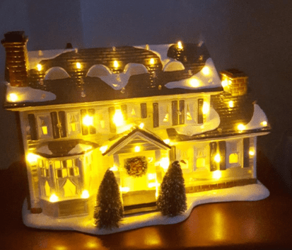 This amazing National Lampoon Christmas Vacation Village lights up as bright as in the movie