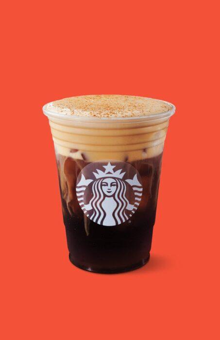 Starbucks cup filled with Starbucks Pumpkin Cream Cold Brew