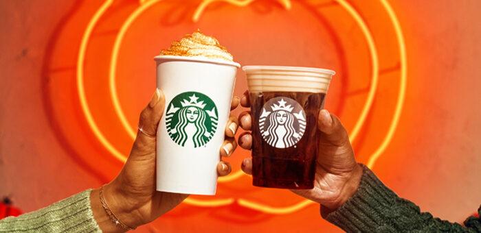 hand holding a Starbucks Pumpkin Cream Cold Brew